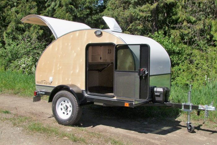 "Northern Teardrop Trailer ""Woody"" shown with options incl: High clearance pkg, Porch lights, Running water"