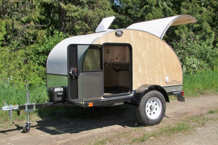 """Northern Teardrop Trailer """"Woody"""" shown with options incl: High clearance pkg, Porch lights, Running water"""