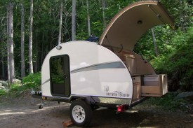 Northern Teardrop Trailer shown with options incl: electric cooler, cargo rack, running water, power roof vent, porch lights
