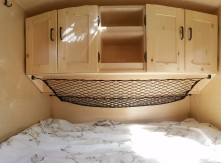 Standard cabinets and 12 volt power outlet come standard in the cabin keeping your clothes, gear in place and organized.
