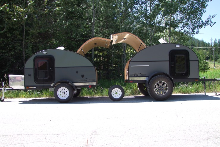 "From left to right: 5x8 Coloured model with High Clearance Pkg, Standard (small) tire only, 5x8 Overlander model shown with 36"" tires (extra)"