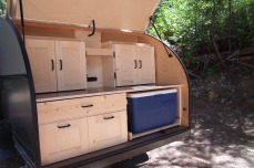 Cabinets with doors keep goods in place and mean no packing, repacking with each move