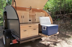 Slide out cooler and campstove included.